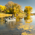 ​Barry Austin fishing below the Fun Farm Bridge in early October with guide, Smitty.